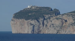 Lighthouse on Capo Caccia Cliff Sardinia Italy -  25FPS PAL Stock Footage