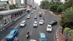 Jakarta bus system and heavy traffic Stock Footage