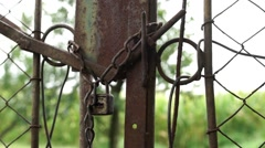 Chain lock on an old gate VEHICLE Stock Footage