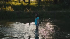 Beautiful Girl is Playing in the River Stock Footage