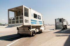 PRM passenger mobility assistance vehicle at airport runway Stock Photos