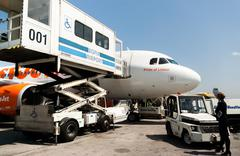 PRM passenger mobility assistance vehicle in action next to an airplane Stock Photos