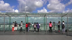 Tourists on the viewing platform (in 4K) on the Tour Montparnasse, Paris, France - stock footage