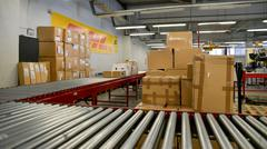 Package boxes for delivery in the DHL storehouse - stock photo