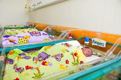 Newborn baby sleeping in bed in hospital Kuvituskuvat
