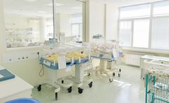 Hospital room with newborn babys sleeping in incubators Kuvituskuvat