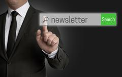 Stock Photo of Newsletter internet browser is operated by businessman.