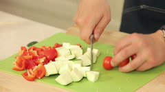 Cheff Is Cutting Cherry Tomatoes, Zucchini and Red Paprika Stock Footage