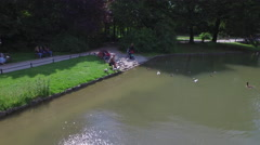 Aerial view of lake with ducks in Munich Stock Footage