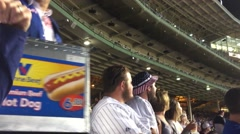 Hot dog vendor at baseball game - stock footage