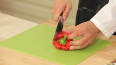Cheff is Slicing Red Paprika on a Cutting Board Stock Footage