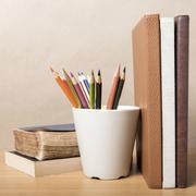 Book and color pencil Stock Photos
