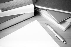 empty paper and pen with book black and white tone style - stock photo