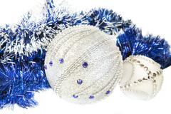 Christmas blue tinsel and blue with white glitter balls Stock Photos