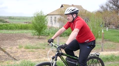 Stock Video Footage of Man riding on a bicycle on countryside rout - fast driving and health life