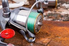 Fishing reel with line on background Stock Photos