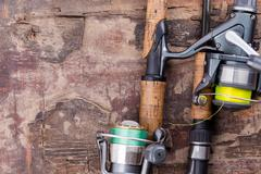 fishing rod and reel with line - stock photo