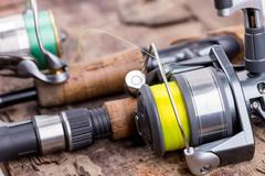 Fishing rod and reel with line Stock Photos