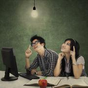 Smart students thinking a bright idea - stock photo