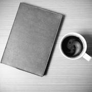 Brown book with black coffee black and white color tone style Stock Photos