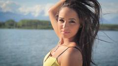portrait of a beautiful brunette woman outdoors - stock footage