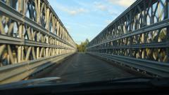 POV driving across a rural bridge over the Goulais River, Ontario, Canada. Stock Footage