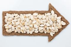 Pointer with pumpkin seeds Stock Photos