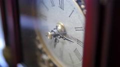 An antique clocks hands turn with time Stock Footage