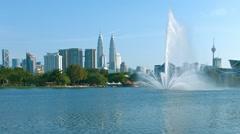 Kuala Lumpur Skyline over a Beautiful Urban Lake Park Stock Footage