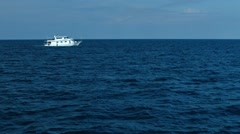 Tour Boat Traversing a Tropical Seascape Stock Footage