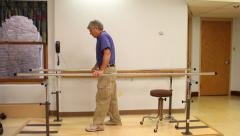 Senior man doing Parallel Bars therapy - stock footage