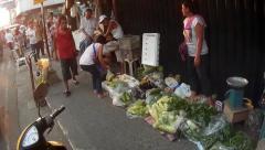 Woman selling vegetable on street Stock Footage
