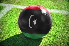 football ball with the national flag of libya - stock illustration