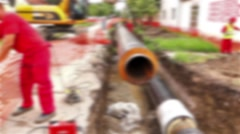 Blurred view on team of workers until assembly a new pipeline. - stock footage