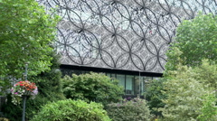 Birmingham Library exterior behind trees and bushes. Stock Footage