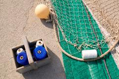 fishing net repair kit with sewing thread spool - stock photo