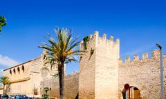 Stock Photo of Alcudia Sant Jaume church near roman castle wall Mallorca