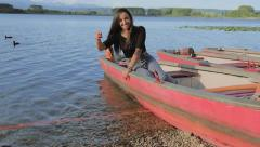 Beautiful Woman Smiling Outdoors On Lake Stock Footage
