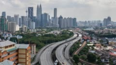 Road lead to Kuala Lumpur city center. Tilt up. - stock footage