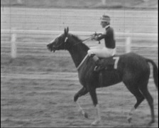 Jockey riding horse after race in b&w super8 film Stock Footage