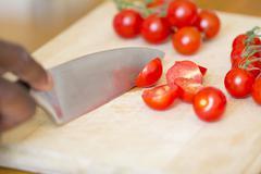 Black Man Chopping Tomatoes - stock photo