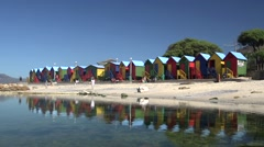 Colourful row of beach huts Stock Footage