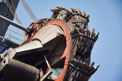 Huge mining machine in the coal mine Stock Photos