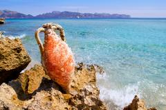 Alcudia Beach Mallorca with roman amphora Stock Photos