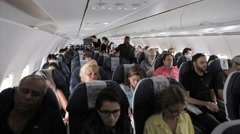 Interior airplane, point of view as passenger from coach seats as travelers depa Stock Footage