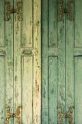 Detail of green wooden shutters. Stock Photos
