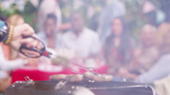 4K Happy mixed ethnicity group of friends raise beer bottles for a toast at bbq  Stock Footage