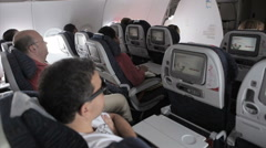 Interior airplane, point of view as passenger from coach seats as travelers depa - stock footage