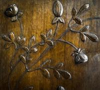 leaves and flowers carved in the wood - stock photo