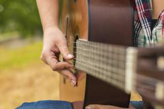 Musician woman and her guitar in good day Stock Photos